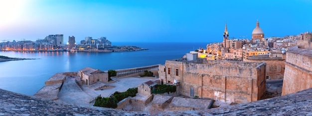Sliema and old town of valletta with churches of our lady of mount carmel and st. paul's anglican pro-cathedral in valletta, capital city of malta