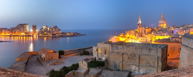 Sliema and old town of valletta with churches of our lady of mount carmel and st. paul's anglican pro-cathedral, valletta, capital city of malta