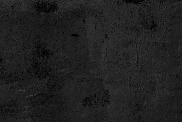 壁に少し隆起があります。抽象的な黒の背景。黒漆喰の質感。暗い粗面。