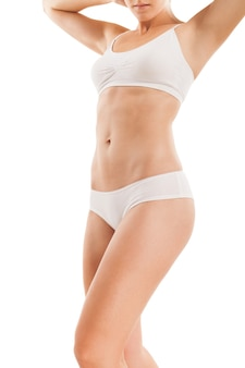 Стройное тело женщины, изолированные на белом.