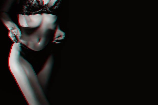 Slim figure of beautiful sexy girl in panties and bra. body skinny fitness women underwear on dark background. black and white with 3d glitch virtual reality effect