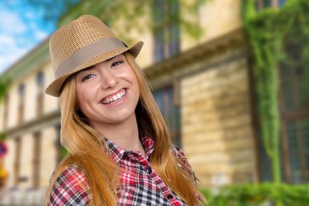 Slim pretty young girl in straw hat
