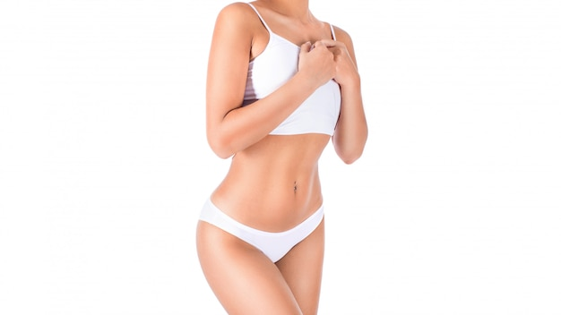 Slim tanned woman's body in white underwear. isolated