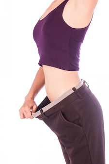 Slim waist of beauty woman in big trousers