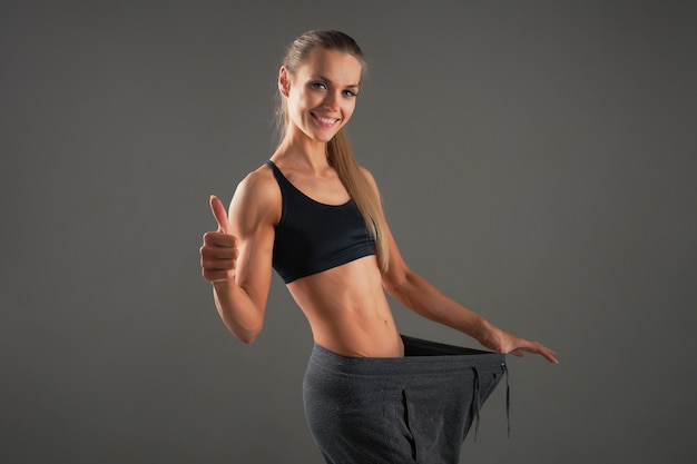 Slim waist of young woman with perfect healthy thin body