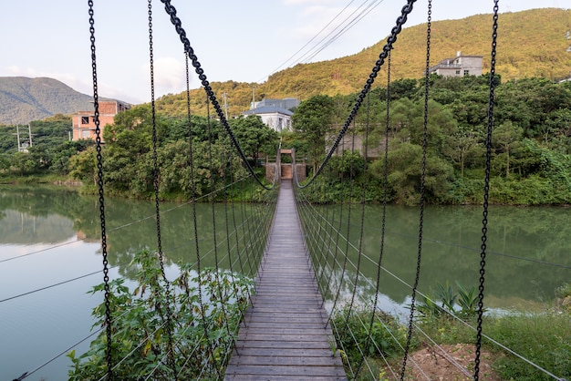 A sling bridge over a country river