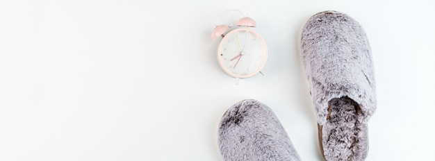 Slippers and alarm clock, top view