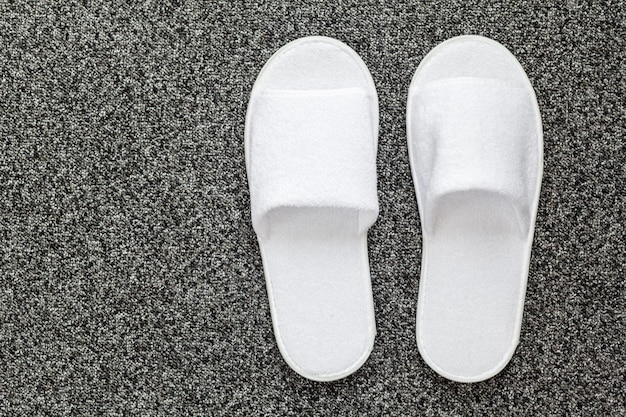 Slippers on the floor of hotel room
