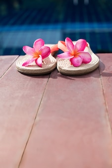 Slippers pink frangipani swimming pool