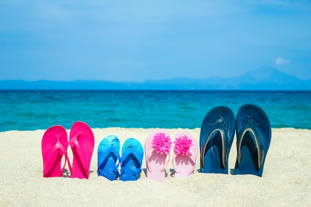 Slippers in the sand by the sea greece