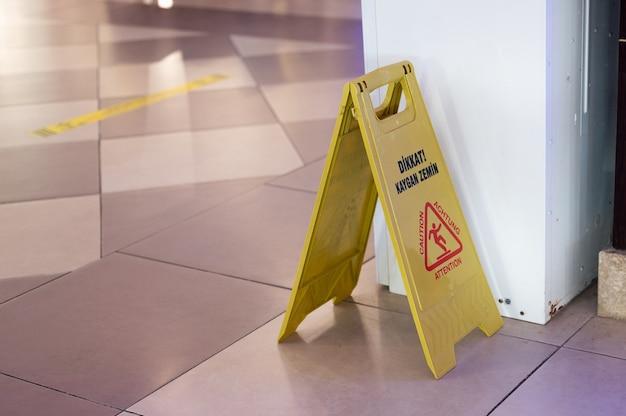 Slippery field warning sign. wet floor.
