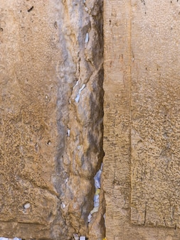 Slips of paper containing prayers in the cracks of the western wall, old city, jerusalem, israel