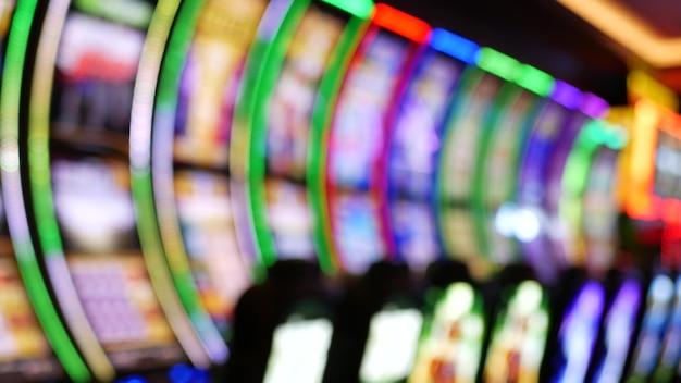 Slot machines glow in casino on las vegas strip,