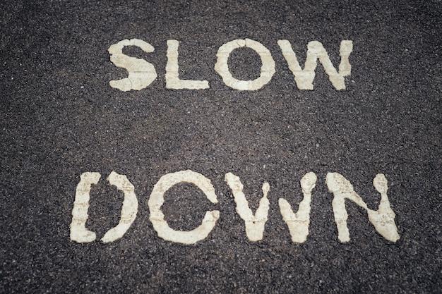 Slow down print on asphalt road