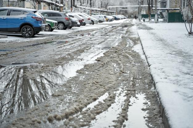 Slush on the road during winter snowfall.