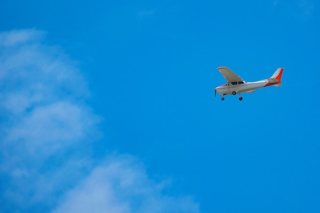 Small airplane or aircraft flying in blue sky.