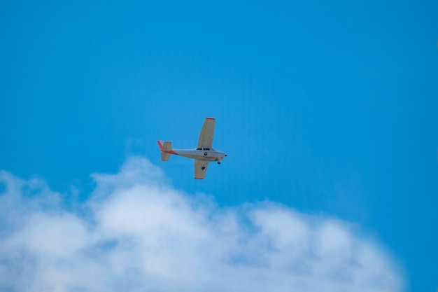Small airplane fly to reduce dust pollution by spraying water in the sky.