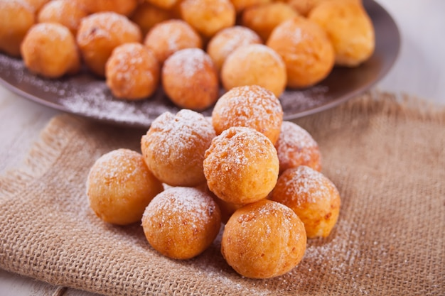 Small balls of freshly baked homemade cottage cheese doughnuts