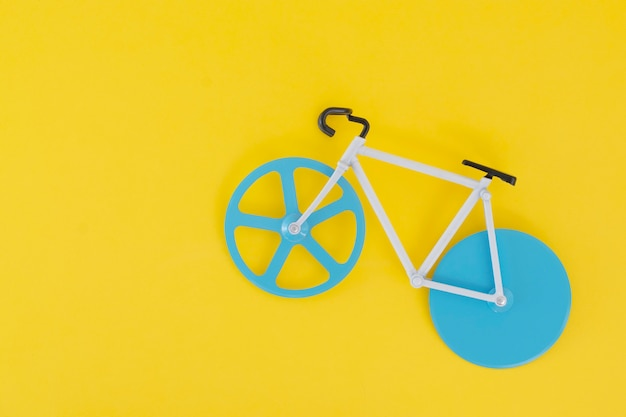A small bicycle on a yellow