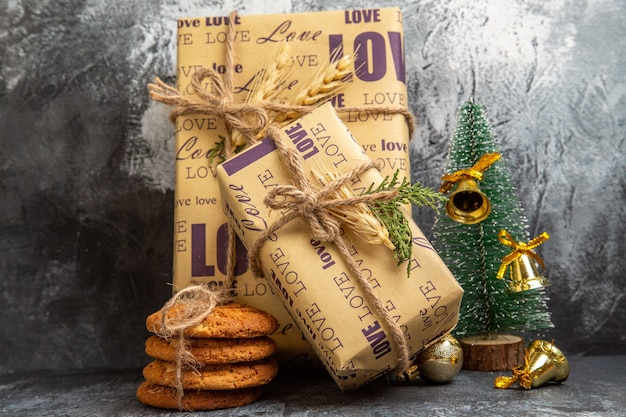 Small and big packed gifts standing on wall and cookies