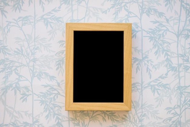 Small blackboard on wallpaper