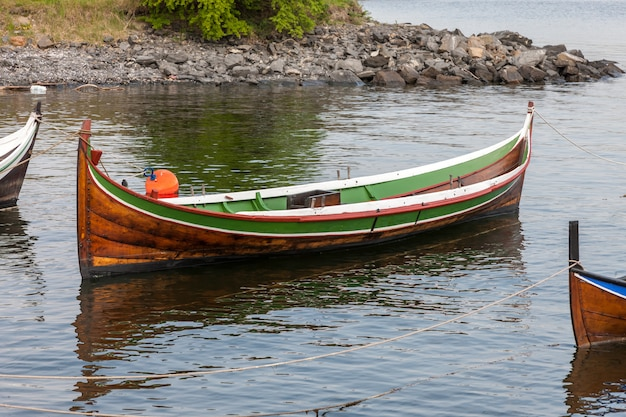 Small boat on clear water