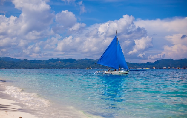 Small boat in open sea on the island of boracay