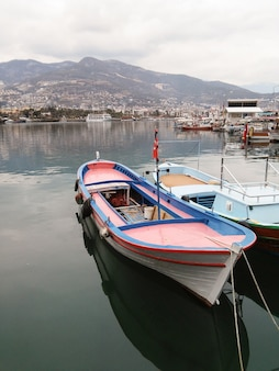 Small boats are in the port.