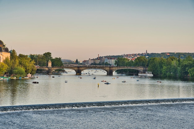 Small boats on the river vltava in prague
