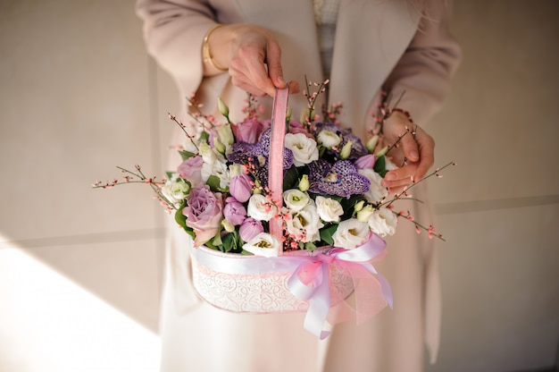 Small bouquet of various flowers in basket