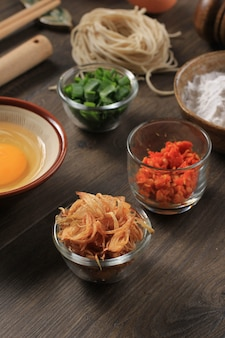 Small bowl of deep fried onion shallots (bawang goreng), usually for topping in indonesian or malaysian food