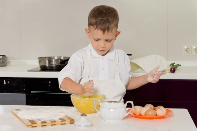 Small boy doing the baking in the kitchen