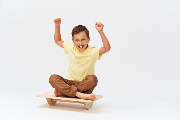 Small boy is sitting on a special simulator for training vestibular apparatus