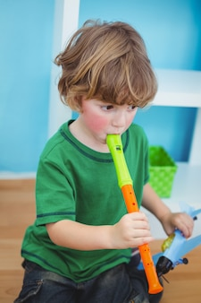 Small boy playing the flute
