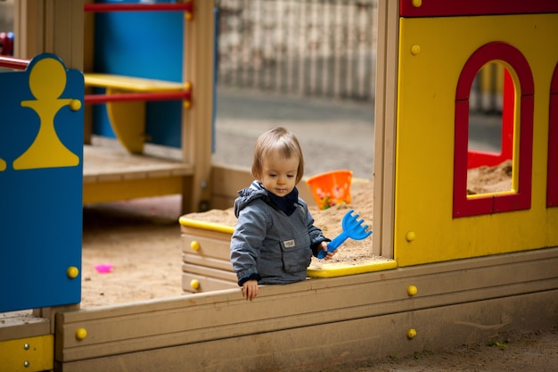 Small boy playing outside