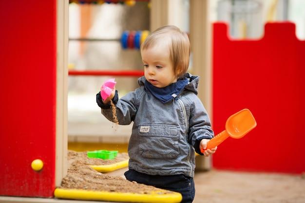 Small boy playing outside