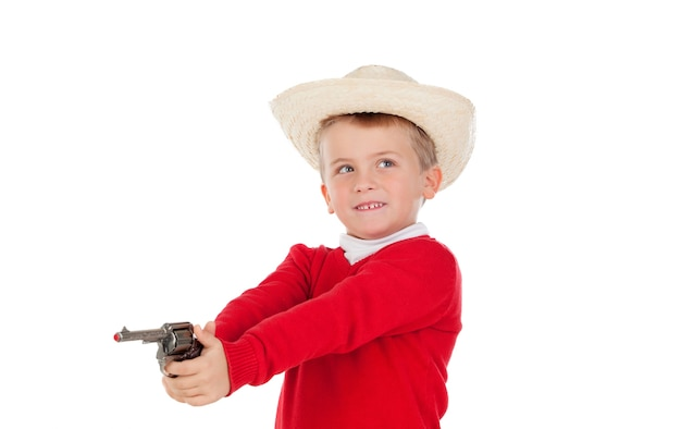 Small boy playing with a gun