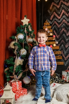 Small boy posing in a christmas photo session