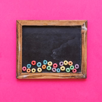 Small bright cereals on blackboard