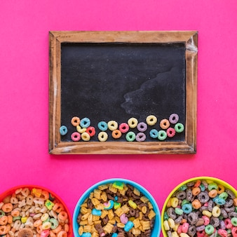 Small bright cereals on chalkboard