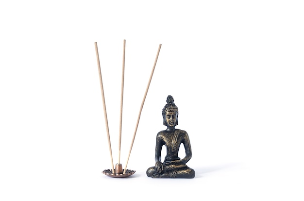 Small buddha statue with incense sticks isolated on white background