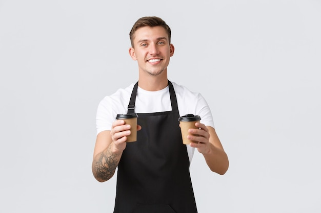 Small business coffee shop cafe and restaurants concept handsome charismatic barista waiter handing ...