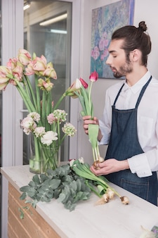 Small business. male florist in flower shop.