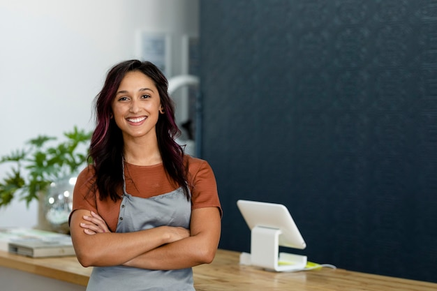 Small business owner at a cash register