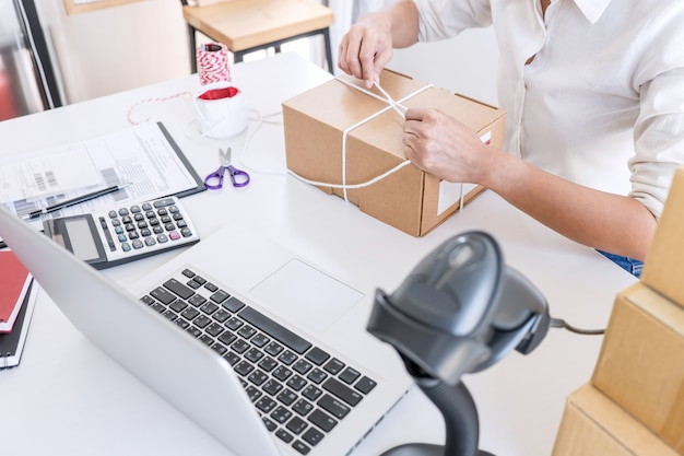 Small business owner delivery service and working packing box