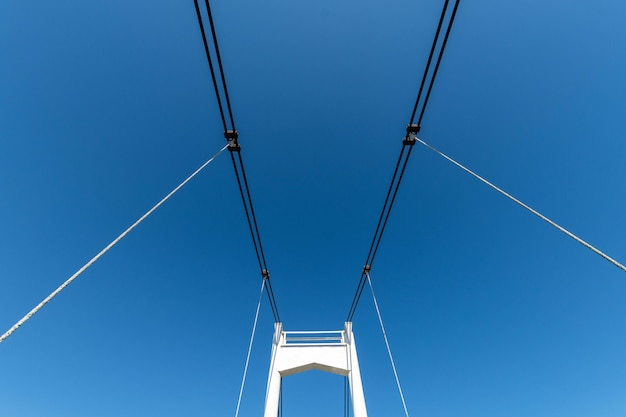 Small cable-stayed bridge over the river. the bridge needs repair. yoshkar-ola city in russia.