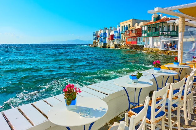 Small cafe by the sea next to the little venice district in mykonos island, greece