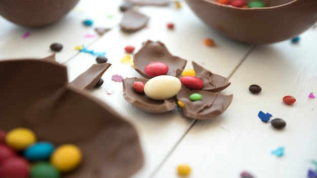Small candies on cracked chocolate piece