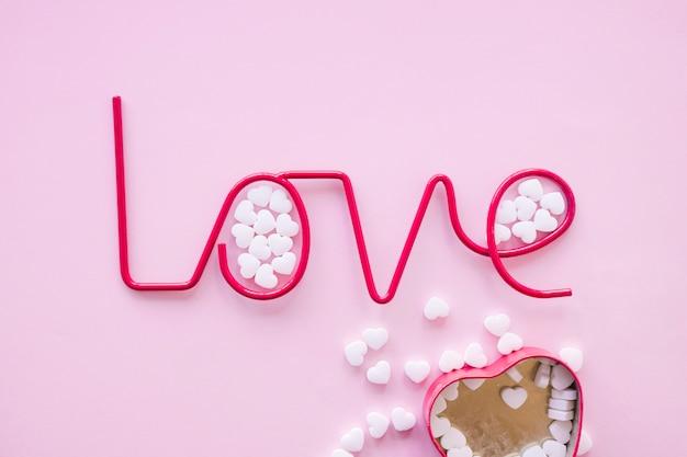 Small candies near love writing