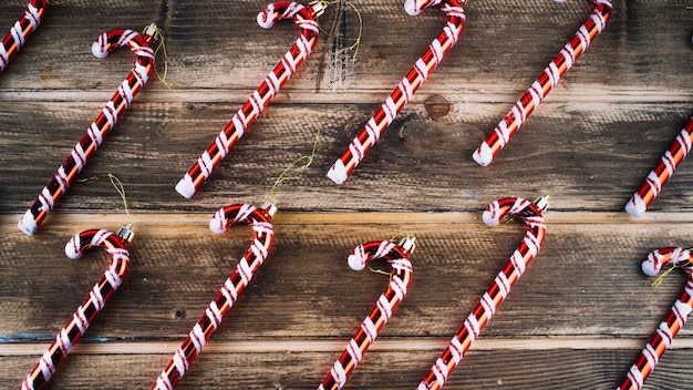 Small candy canes on wooden table